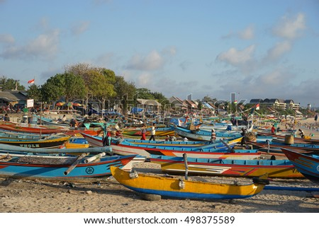 Bali Indonesia October 16, 2015 : Sunset scene of daily activities at Jimbaran village pictured on Oct 4, 2015 in Bali Indonesia. Jimbaran village is among famous place to see fisherman life in Bali.