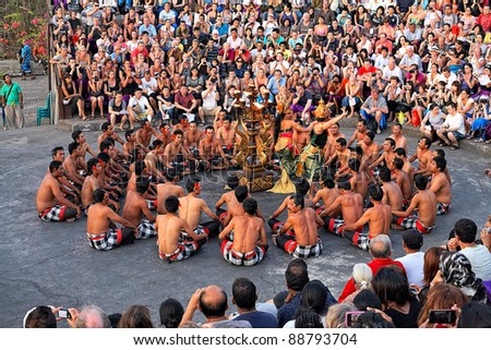 BALI, INDONESIA - OCTOBER 25: Unidentified dancers participate in a Balinese Kecak dance also known as the Ramayana Monkey Chant on October 25, 2011 at  temple Uluwatu, Bali, Indonesia - stock photo