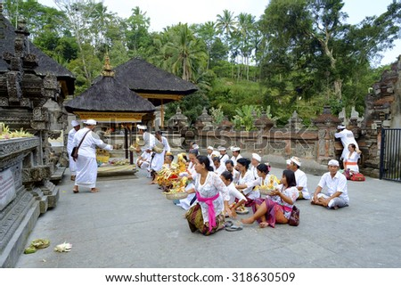 Bali, Indonesia - September 19, 2014 : Local Balinese praying at holy spring water temple Pura Tirtha Empul during the religious ceremony  in Tampak Siring, Bali, Indonesia.