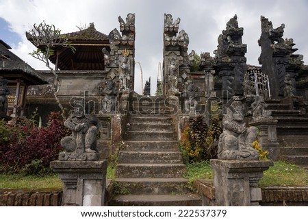 BALI, INDONESIA - SEPTEMBER 20, 2014: Many private temples are found inside the Besakih Temple Complex. It is the largest and most important Hindu temple on Bali Island. - stock photo
