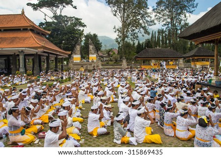 BALI, INDONESIA - September 10, 2015 : Unidentified Indonesian people go to celebrate Balinese ceremony at Pura Ulun Danu temple. - stock photo