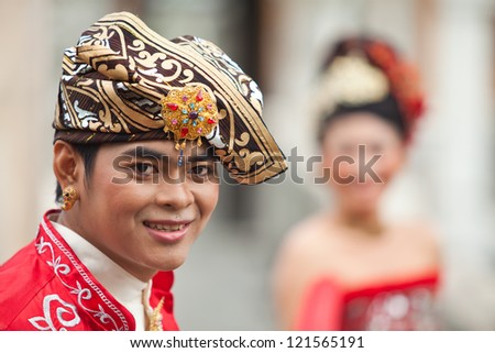 BALI - JANUARY 29. Performers enacting wedding scene in preparation for religious ceremony on January 29, 2012 in Bali, Indonesia. Most Balinese get married in their early 20s. - stock photo