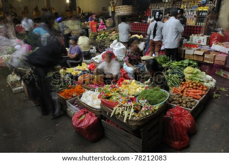 BALI - MAY 4: Commercial activities at Ubud market on May 4, 2011 in Bali, Indonesia. Ubud Market is very famous among Balinese, located in center of Ubud Village and in front of Ubud Palace. - stock photo