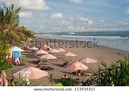 BALI- MAY 9: Located on the western side of the island's narrow isthmus, Kuta Beach is Bali's most famous beach resort destination. May 9, 2011 in Bali, Indonesia - stock photo