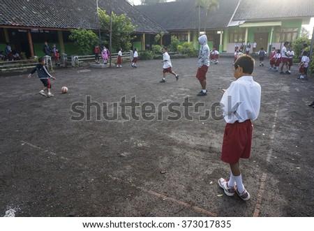 BALI, NUSA PENIDA ISLAND, INDONESIA - JULY 28, 2015: Group of young balinese boys with school uniform on July 27, 2015 in Bali, Nusa Penida Indonesia - stock photo