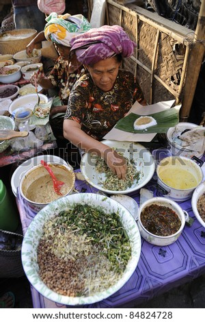 BALI - OCT 15: Commercial activities at Ubud market on Oct 15, 2010 in Bali, Indonesia. Ubud Market is very famous among Balinese, located in center of Ubud Village and in front of Ubud Palace. - stock photo