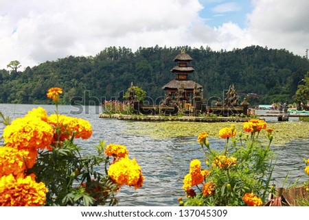 Bali temple, with marigolds in front - stock photo