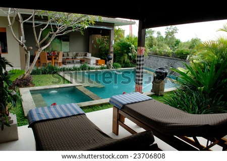 Bali Villa with swimming pool and relaxation bed. - stock photo