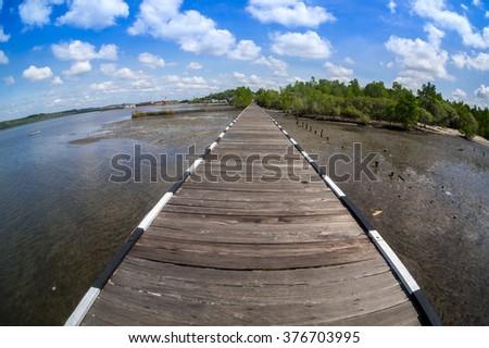 BALIKPAPAN, INDONESIA - FEB 8: Atmosphere at Jembatan Ulin Kariangau on Feb 8, 2016. The bridge is 800m long and surrounded by mangrove tree. - stock photo
