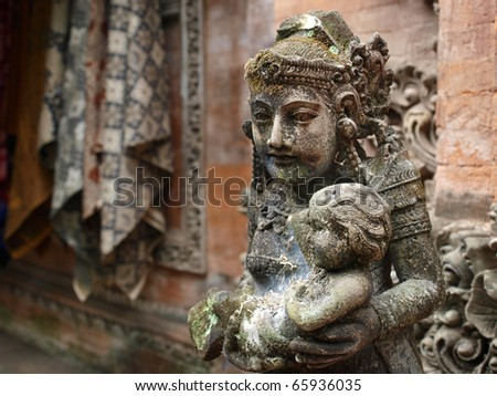 Balinese godess with child - stock photo