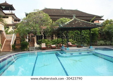 Balinese resort with swimming pool - stock photo