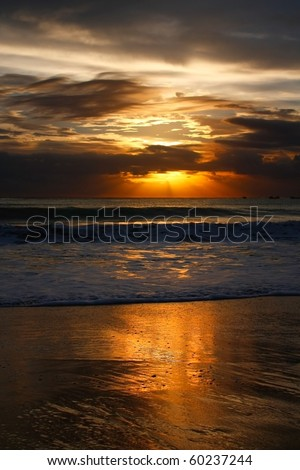 Balinese sunset on Jimbaran beach - stock photo