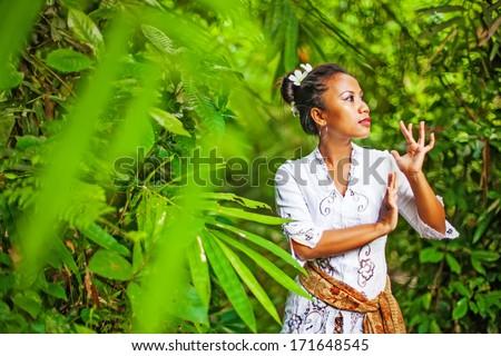 balinese woman dancing barong and legong dance - stock photo