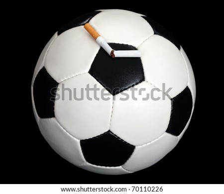 Ball and a broken cigarette - stock photo