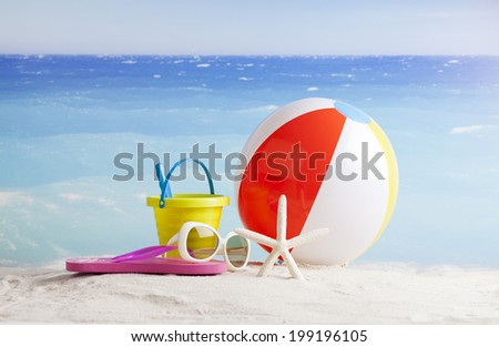 ball and accessories at the beach   - stock photo