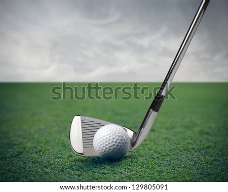 ball and golf club - stock photo
