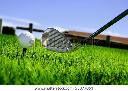 ball and golf clubs on the bright green grass - as a symbol of success - stock photo
