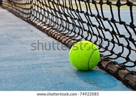 Ball and net on tennis court