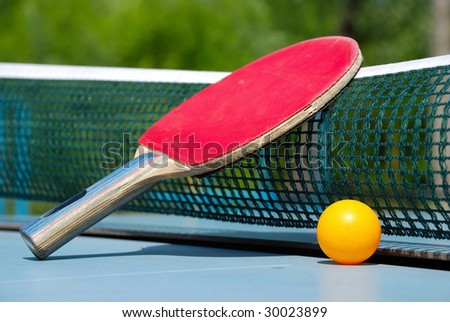 ball and paddle for table tennis - stock photo