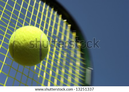 Ball and Racket - Tennis racket and yellow tennis ball sky blue - stock photo