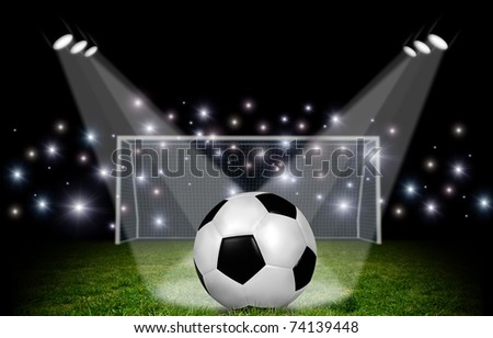 Ball and stadium at night - stock photo