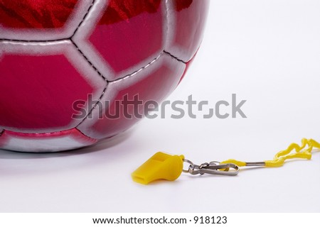 Ball and whistle on a white background - stock photo