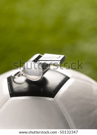 ball and whistle on soccer field - stock photo
