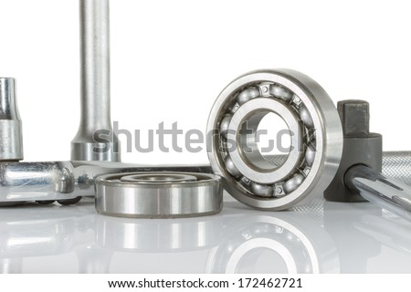 ball bearing with drive socket set , on over white, and reflections - stock photo