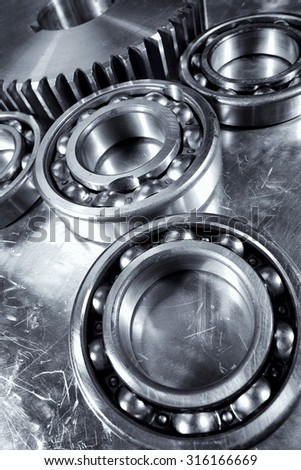 ball-bearings and gears, aerospace titanium and steel parts, blue metal toning concept - stock photo