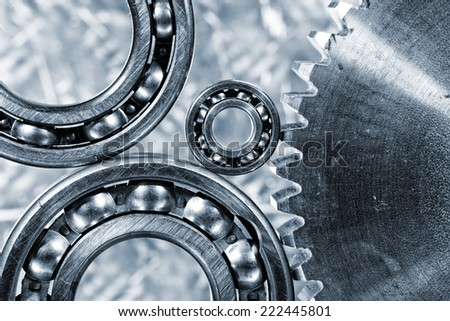 ball-bearings and large cogwheel in close-ups, imaginative concept - stock photo