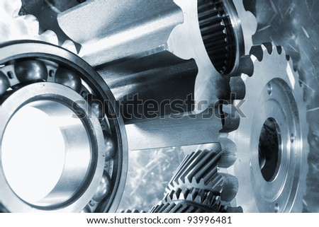 ball bearings and pinion wheels, blue duplex toning concept - stock photo