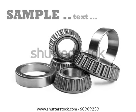 Ball bearings on a pure white background with space for text - stock photo