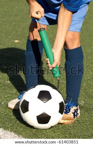 Ball  football  repair  inflating - stock photo