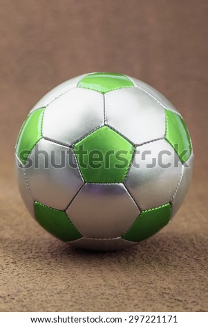 ball for playing football on a green background - stock photo