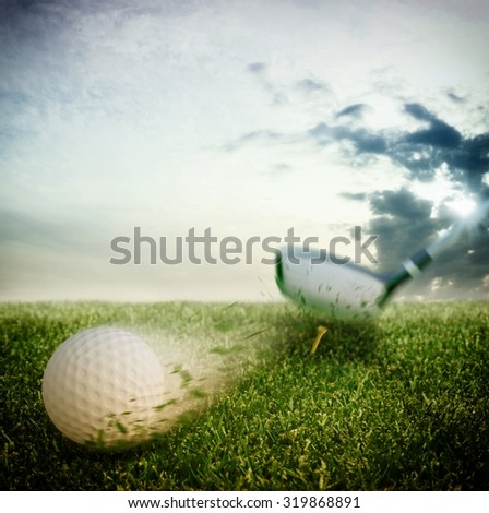 Ball hit hard by a golf club - stock photo