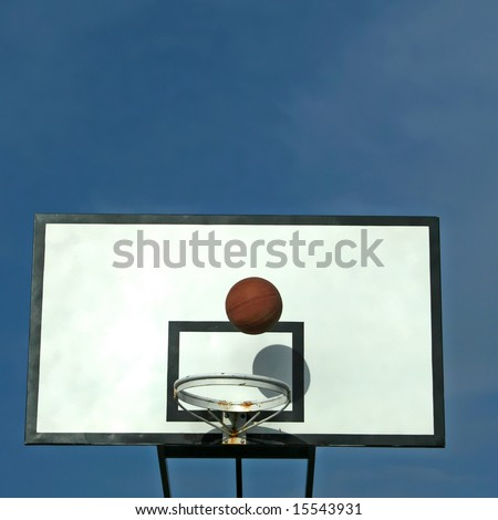 ball in basket in old basketball table - sport symbols - square format - stock photo