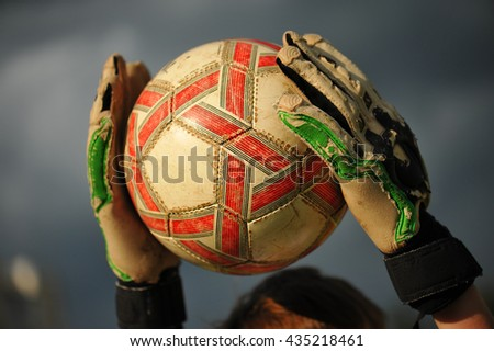 ball in hands of the goalkeeper, close-up.