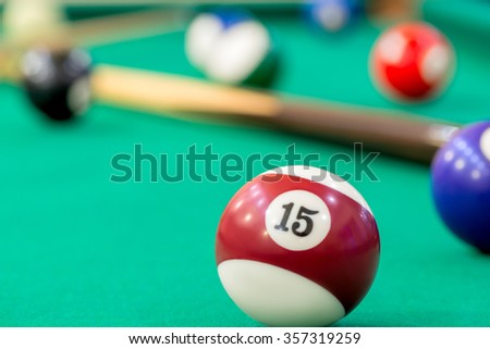ball number 15 on the table of billiard close-up