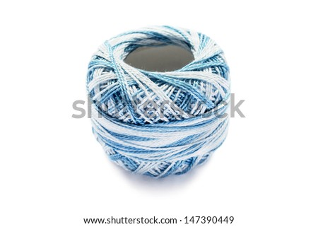 Ball of bicolor blue yarn isolated on white background