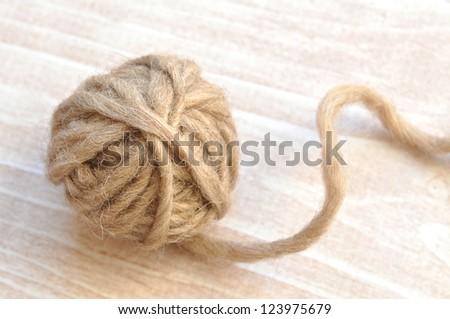 Ball of brown wool yarn - stock photo