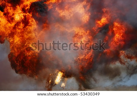 Ball of fire and smoke at moment of explosion - stock photo