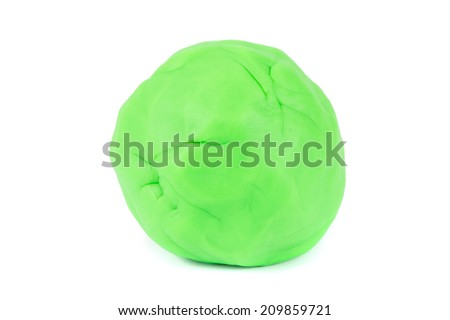 Ball of green play dough on a white background - stock photo