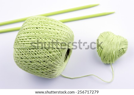 ball of knitting yarn forming a heart - stock photo