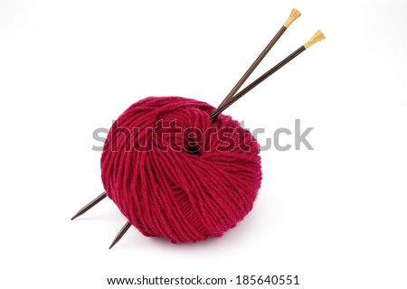 Ball of Red Yarn and Knitting Needles - stock photo