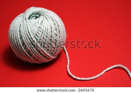 ball of string on red - stock photo