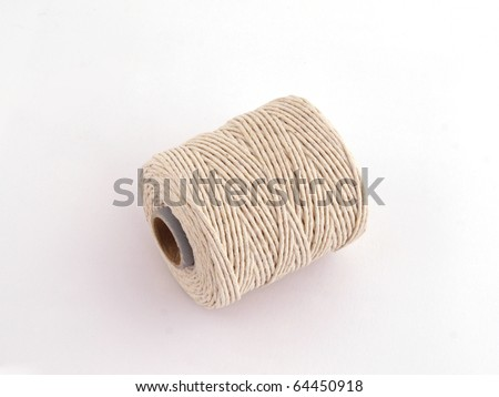Ball of string or twine on a plain white background. - stock photo