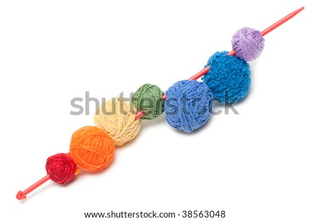 Ball of the colour threads strung on spoke - stock photo