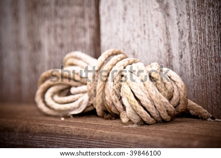 Ball of white twine cord ball wooden ledge - stock photo