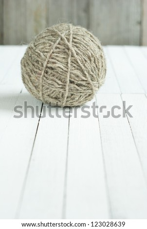 ball of wool on wooden background