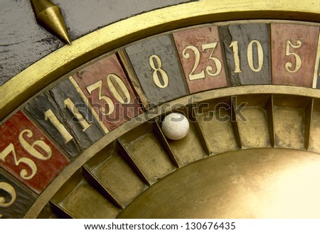 Ball on a vintage roulette with numbers - stock photo